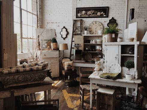 Cluttered room full of vintage and furnishings